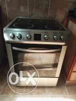 Electrical oven with air function and 4 burners