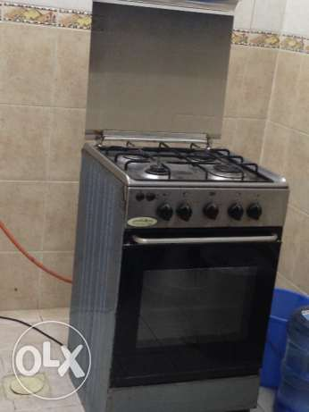 Cooking range plus gas cylinder