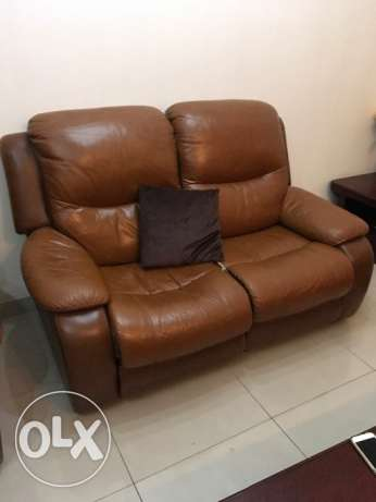 Luxury leather sofa with leg support