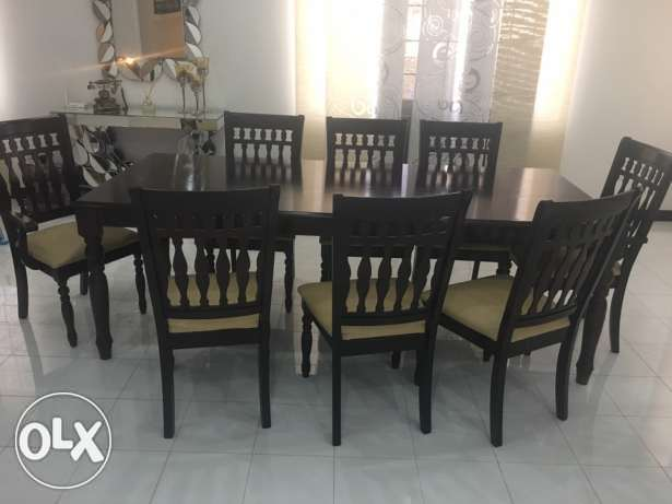 dinning table (8 chairs) very good condition 140 ORS only