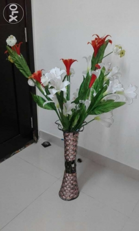 artificial flowers with stand.