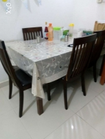 Medium sized dinning table with four chairs. Available
