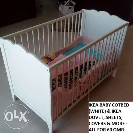 IKEA Baby Cotbed for sale. Includes Mattress and Side Cover. The bed i