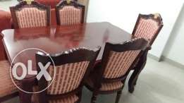 Wooden dining table with six chairs. Good condition