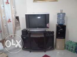 """Sanyo 29"""" Flat TV along TV Stand and 5.1 Speakers Urgent Sale in Qurum"""