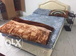 Queen size bed with mattress.