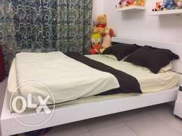 king size bed with mattress and 2 side tables