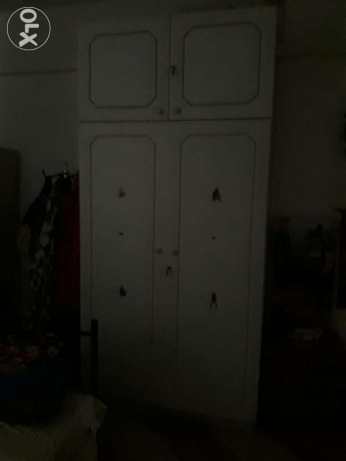 Large white solid long wooden two-door cupboard