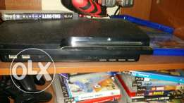 Ps3 with 2 controlllers+20 games+driving wheele