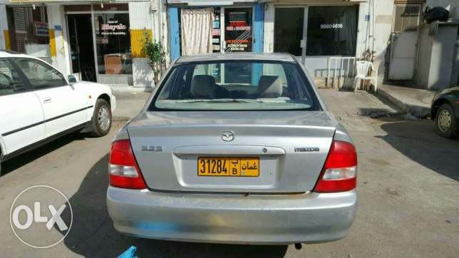 Mazada 323 with one year passing want to sale مسقط -  2