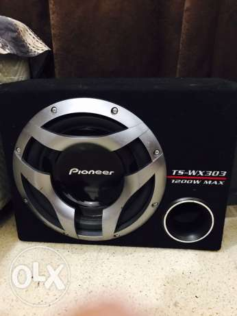 Pioneer subwoofer with Kenwood amplifier.