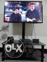 "42"" LG TV with black glass stand"