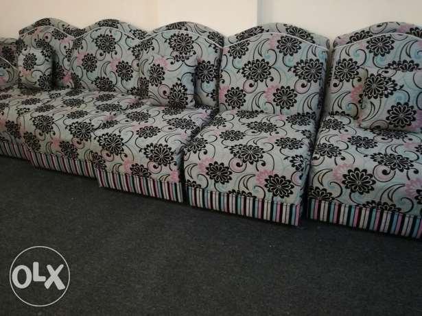 Two sofa + for chair + six pillows + table.