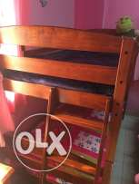 Wodden Bunk bed nd a single bed for immediate sale in wadi kabir