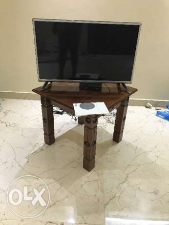 TV 32 inch with wooden stool and dish TV set top box