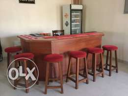 Bar with stools, Captain's chair and glass fronted drinks fridge