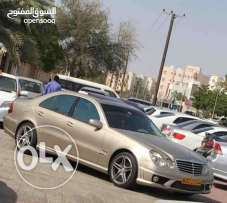 Mercedes Benz E-class with body kit E63 and exhaust system