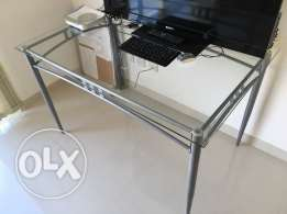 Glass table with a study chair