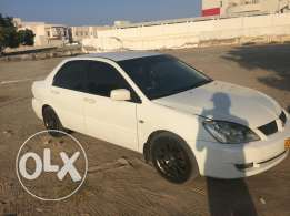 Mitsubishi lancer. 2007 model. The tyres are sporty. Can be modified.