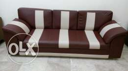 Leather sofa (3 seater) + (1 wodden stachew absolutly free)