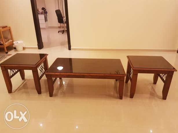 Solid wood tables with glass