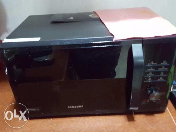 Samsung Brand new one month used microwave with grill for sale
