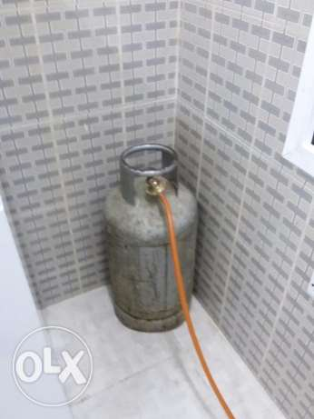 LPG gas cylinder with stove (Rinnai) brand new condition مسقط -  1