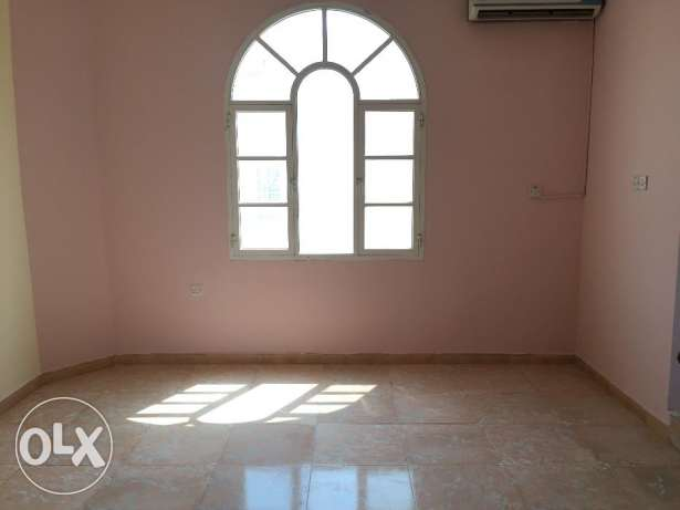 flat for rent in a villa with balcony in almawaleh south مسقط -  1