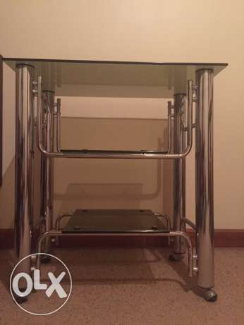Steeland glass Tv stand with wheels ( can dismantle)