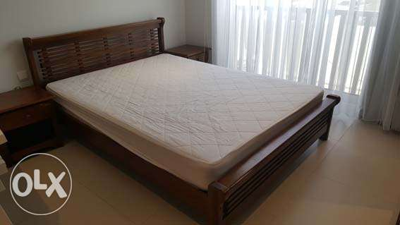 Queen size bed plus mattress plus 2 side tables with drawers