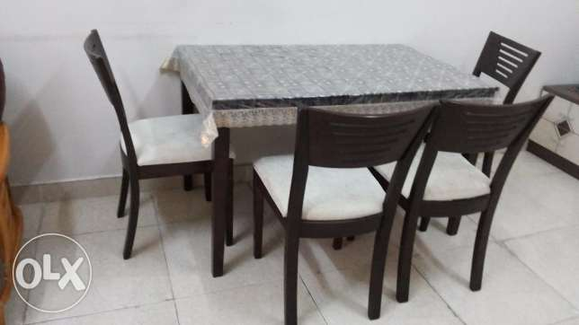 Rose wood dining table with 4 chairs