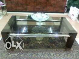 Glass top centre table with carpet