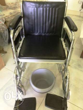 Stainless Steel Folding Wheel Chair with Detachable Toilet Pan