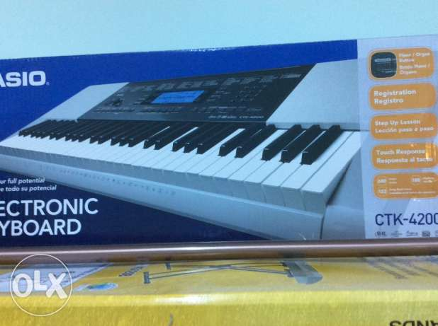 Casio Musical Electronic Keyboard with Stand مسقط -  3