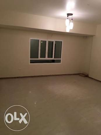 a new flat for rent in al mawaleh 11 in a new building