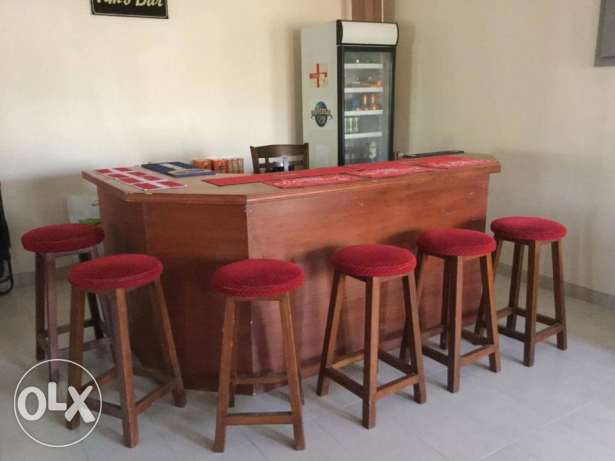 Bar with stools, Captain's chair and glass fronted drinks fridge مسقط -  1