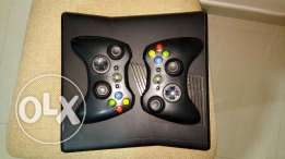 Xbox 360 with 2 controllers and 34 games