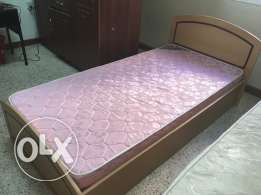 Single wooden bed with medical mattress