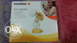 Medela Minielectric breast pump with milk bottle.