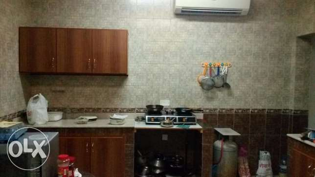 Room with attached bathroom &separate Kitchen for rent in Villa-Azaiba مسقط -  4