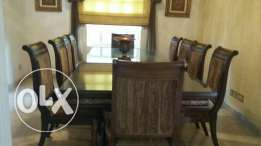 A hood and solid wood dining table and chairs