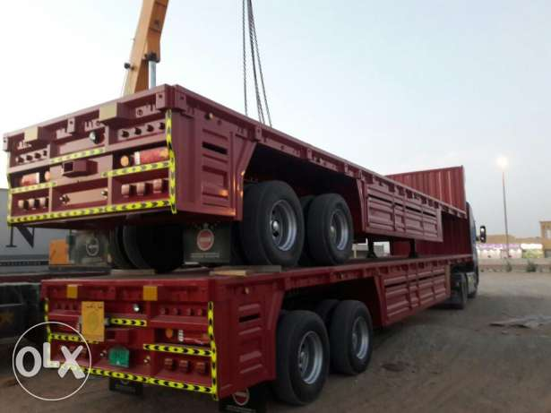 brand new flat bed bogie trailer with 65 ton capacity and warranty