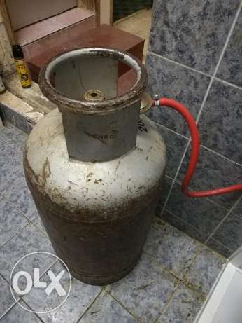 Gas cylinder with stoove, pipe and regulator fariq mukhtar market