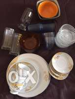 Unused plates, cups, glasses, bowls & kitchen items