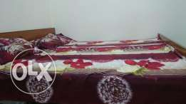 King size Bed with two single medical mattress in very less price.
