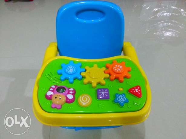 Booster Baby Chair with Musical Play board.
