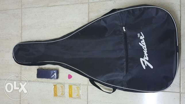 New 01 COVER for guitar, new 01 BELT,new 02 string E & B al in 10-OMR السيب -  3