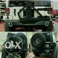 Jeep jk tire carrier and bumper. تايركريل وبنفر حديد للجيب رانجلر