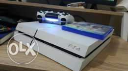PS4 500GB with warranty, two pads and two games.
