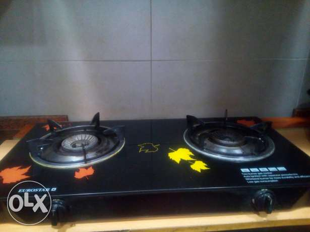Gas stove with cylinder